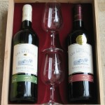 2 bottles and 2 glasses in a wooden box